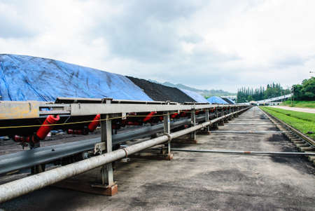 conveyor rail: Coal was transported by coveyor belts from open-pit mine to the stock pile, Mae Moh mine, Lampang, Thailand