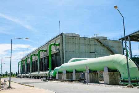 cooling towers with big green pipes in natural gas power plant, Ratchaburi, Thailand