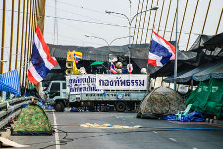 af: Bangkok, Thailand – Jan 23  Thai anti-government protesters camp on the Rama 8 bridge on Jan 23, 2014 Bangkok, Thailand  Rallies against a proposed amnesty for most political offenses stretching back to a 2006 coup that toppled Yingluck's brother, Tha