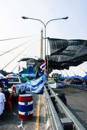 Bangkok, Thailand – Jan 23  Thai anti-government protesters camp on the Rama 8 bridge on Jan 23, 2014 Bangkok, Thailand  Rallies against a proposed amnesty for most political offenses stretching back to a 2006 coup that toppled Yingluck's brother, Tha Editorial