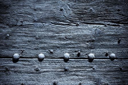 close-up detial of old wooden door in lourmarin provance france photo