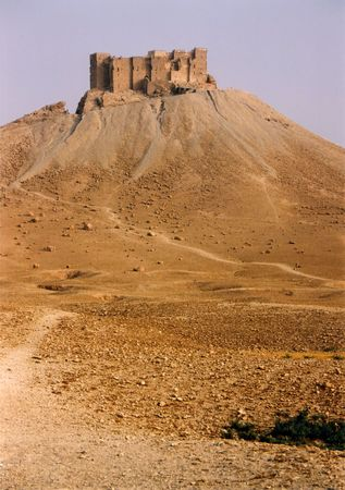 assasin: arab citadel overlooking the ruins of palmeira in syria Stock Photo