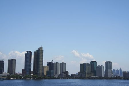 populations: high rise condominiums lining manilas baywalk and ermita waterfront districts seen from manila bay
