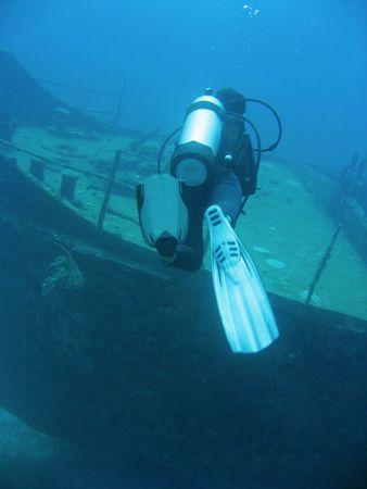 scuba diver diving ship wreck in boracay the philippines Stock Photo
