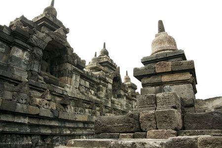 buddha seated in wall alcove, borobudur ruins near yogyakarta in java indonesia photo