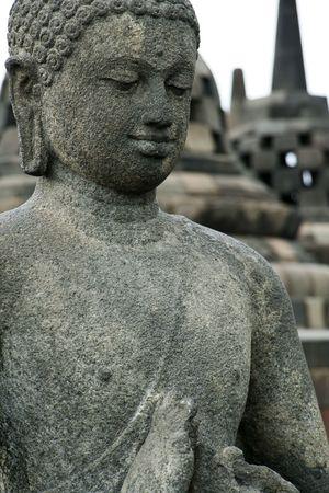 detail of buddha statue at the borobudur ruins near yogyakarta in java indonesia photo