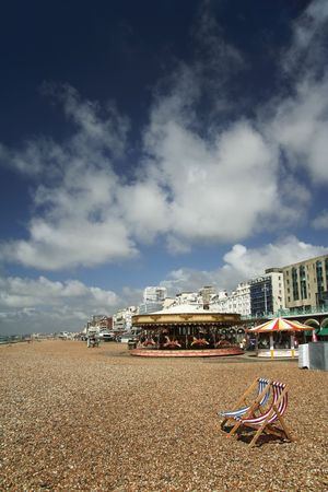 pebble beach with red and blue striped canvas deckchairs, brighton, england