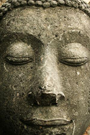 decapitated buddha in the ancient thai capital of ayutthaya photo