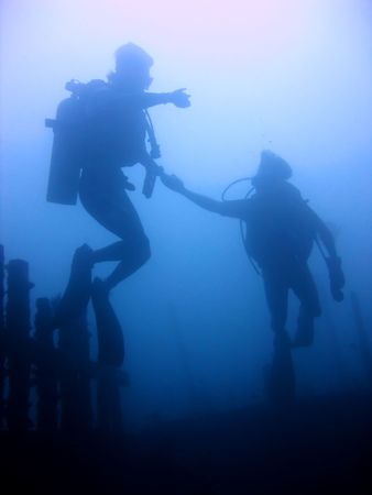 padi: divers begin ascent from wreck in puerto galera in the philippines