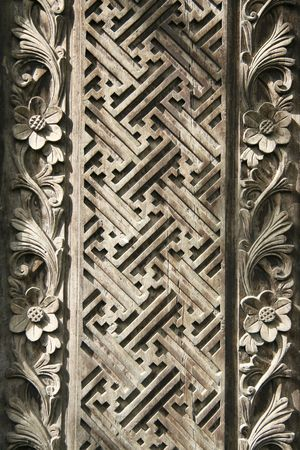 detail of old decorative wooden panel in bali indonesia photo