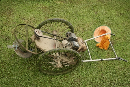 antiquated lawn mower in sukothai thailand Stock Photo - 6558595