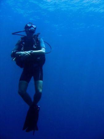 deep sea diver: scuba diver in sabang puerto galera mindoro the philippines