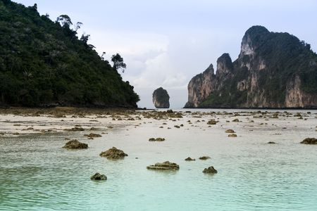 karst formations surrounding the azure shallow lagoons of koh phi phi don isalnd on the andaman coast of thailand photo