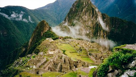 the inca trail overlooking ruined incan city of machu picchu near cusco in peru south america