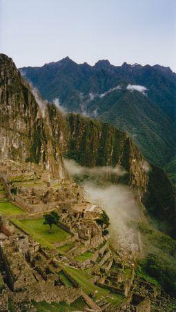 incan: the inca trail overlooking ruined incan city of machu picchu near cusco in peru south america