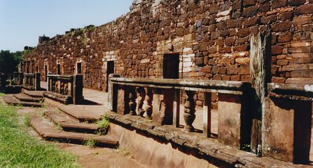 jesuit mission of San Ignacio Mission with three stone columns, two doors and two windows. blue skies over the ruined walls of the jesuit mission of San Ignacio in Provincia de Missiones in Argentina South America