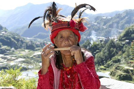 old ifugao woman playing musical instrument wearing traditional dress by the rice terraces of banaue in northern luzon in the philippines Stock Photo - 6890122