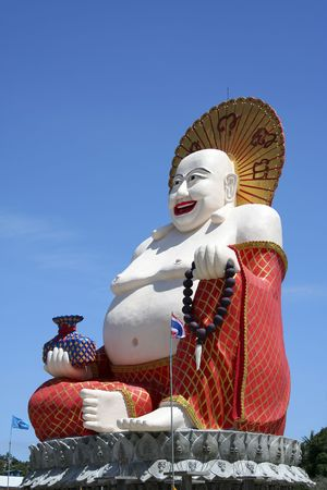 giant colorful buddha statue at wat plai laem temple on koh samui thailand photo