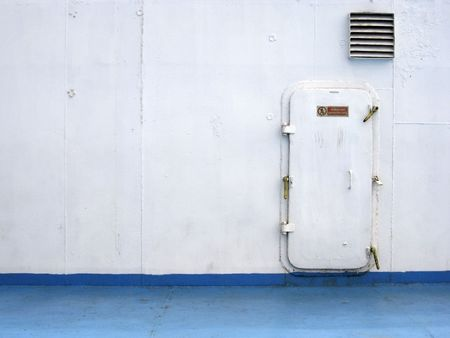 padlocked: sea door onboard large ferry painted blue and white Stock Photo