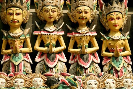 fash: Traditional wooden carvings at temple in ubud bali