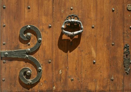 lourmarin: detail antique locks and hinges on old wooden door in provence france