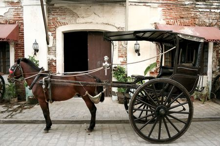 traditional calesa, a horse drawn cab in the philippines, dating from the spanish colonial period and still used in some parts of luzon, such as here in vigan
