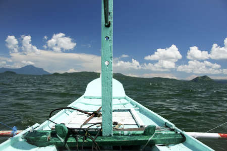 crossing lake taal in a traditional banka outrigger near tagaytay in the philippines photo