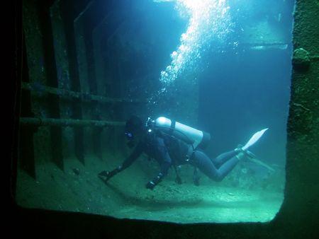 scuba diver inside wreck in boracay the philippines Stock Photo