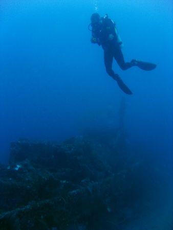 scuba diver exploring wreck off gili trawangan lombok indonesia photo