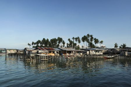 a rural community: stilt houses of fishing village on mabul island, sabah, malaysian borneo