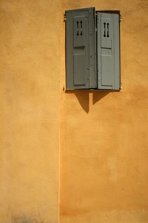 travel features: detail of old walls in historic grasse, south of france Stock Photo