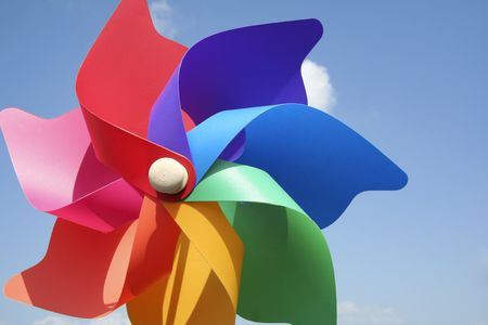 close-up of childs plastic windmill toy shot against clear blue sky