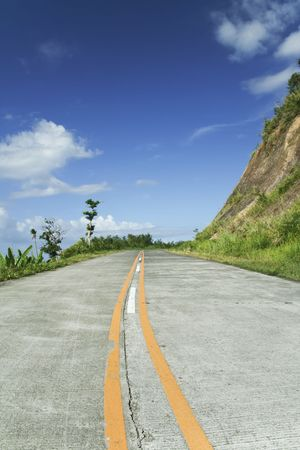 rural road climbs through the mountains in southern luzon in the philippines,  photo