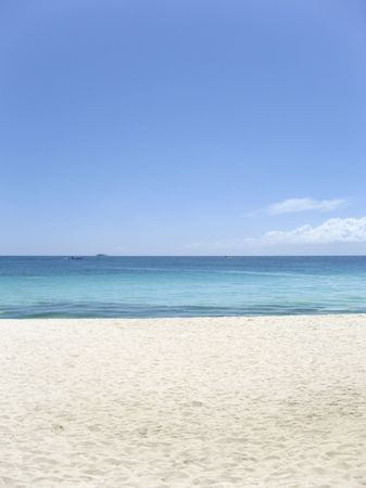 white sand blue sea and clear sky of boracay island in the philippines
