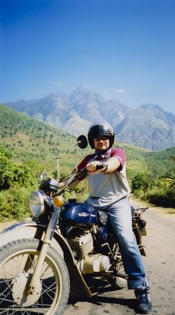 sa: tourist riding russian motorbike in mountains of northern vietnam near sa pa