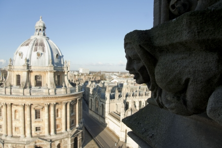 landmark 18th century palladian architecture of the circular radcliffe camera library buildings in oxford england as seen from the belfry of University Church of St Mary the Virgin  photo