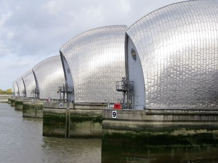 greenwich: londons thames barrier flood defenses crossing the river near greenwich Stock Photo