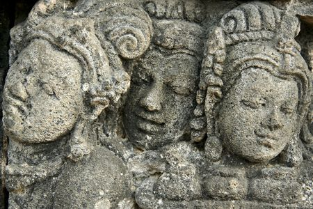 reliefs carved into the walls of the borobudur ruins near yogyakarta in java indonesia photo