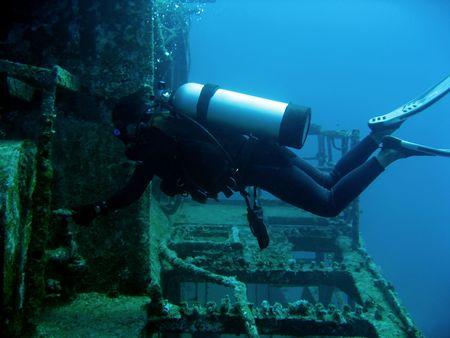 scuba diver exploring ship wreck in boracay the philippines Stock Photo - 6670351