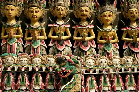 puppets: traditional wooden carvings at temple in ubud bali