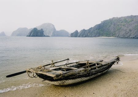 tradional: small tradional rowing boat on the beach halong bay vietnam Stock Photo