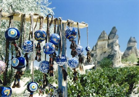 traditional turkish nazar bonjuk evil eye charms for sale at market amongst fairy chimneys in cappadocia turkey Stock Photo