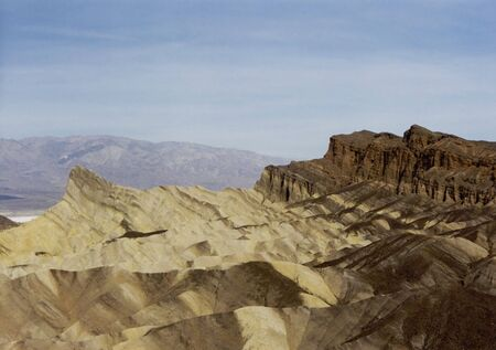 eroded landscape of Zabriskie Point in the Amargosa Range located in Death Valley National Park, California  photo