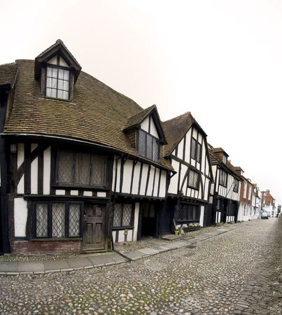 ancient tudor houses line the cobbled street of historic rye in east sussex england photo