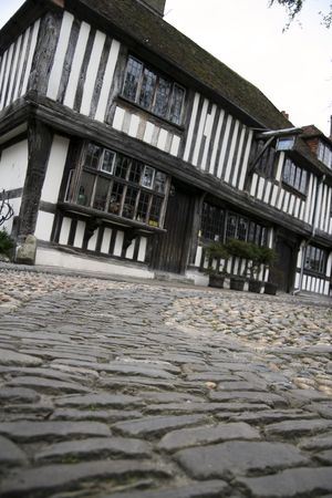low angles view of cobbled streets and anicent tudor half timber houses of historic rye in sussex england photo