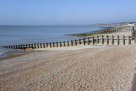 hastings: pebble beach of st leonards in hastings east sussex england with groynes to prevent coastal erosion