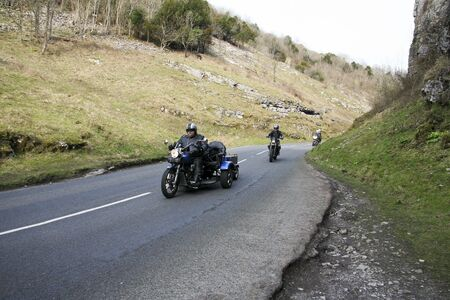 big biker on tricycle riding through the cheddar gorge in somerset england