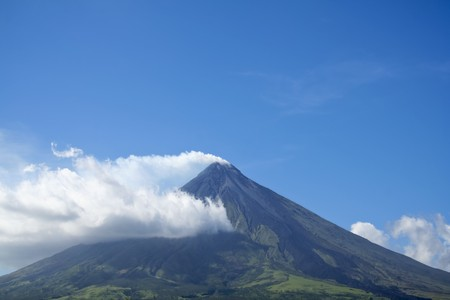 active volcano: symmetrical cone of mount mayon and active volcano in albay province luzon island in the philippines Stock Photo