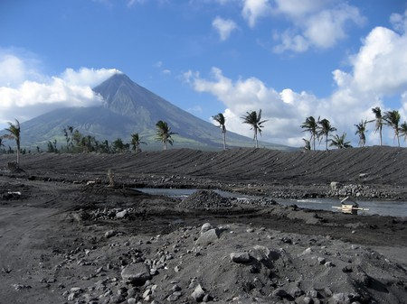 mayon: river flowing through debris field from eruption of mount mayon volcano albay province luzon island in the philippines