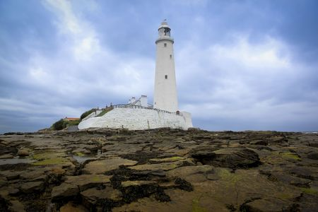 mary's: st marys lighthouse in whitley bay on the northeast coast of england, first operational in 1898 and decomissioned in 1984 , the island is reached at low tide across a causeway Stock Photo